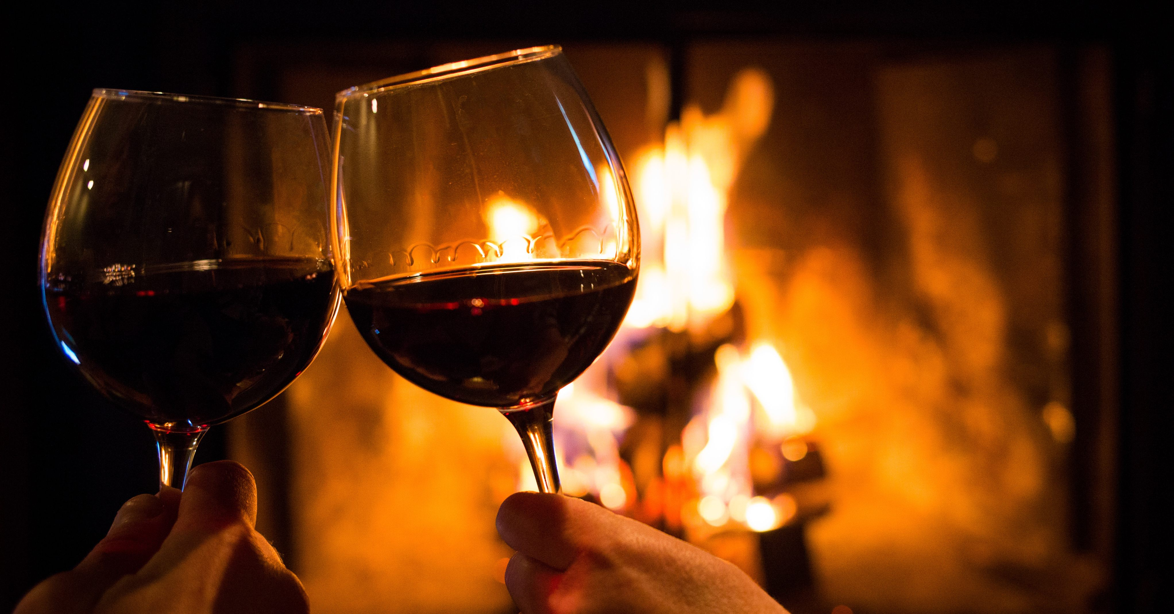 The Best Winter Wines for Hearty Eating - wine glasses, clinking, log fire – Haskells